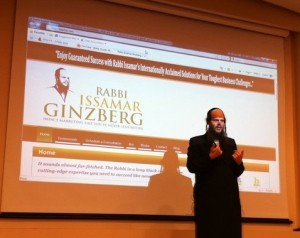 Rabbi Issamar Ginzberg on stage