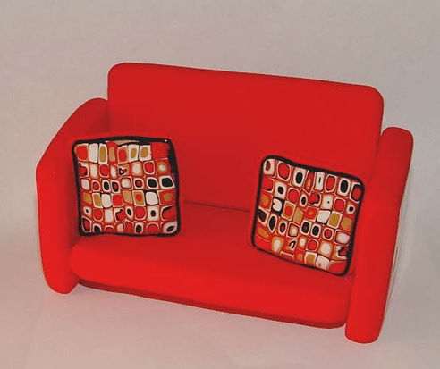 red retro couch business card holder